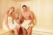 Happy family in the sauna