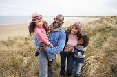 picture of family vacations  - Black Family on a beach - JPG