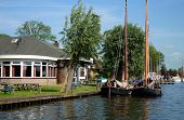 picture of flatboat  - Restaurant at canal and traditional Dutch flat boats  - JPG