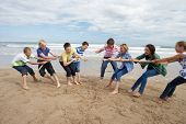 stock photo of tug-of-war  - Teenagers playing tug of war - JPG