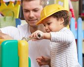 stock photo of nursery school child  - Man with children playing together - JPG