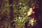Beauty And Nature, Girl Or Cute Woman With Flower In Brunette Hair, Hairstyle Posing In Green Tree L poster
