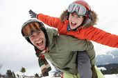 stock photo of pre-teen boy  - Young Father And Son On Winter Vacation - JPG