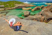 Woman Sitting On The Cliffs Above Elephant-shaped Rocks Of Elephant Rocks In Denmark, Western Austra poster