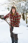 Young man clearing snow