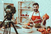 Blogger Makes A Video. Blogger Is Smiling Beard Man. Video About A Cooking. Camera Shoots A Video. L poster