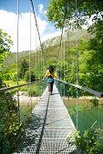 Walking On Metal Footbridge