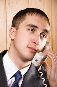 Business Man Speaking On A Telephone