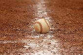 stock photo of infield  - Baseball on the Infield Chalk Line - JPG