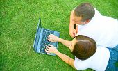Caucasian Couple Using Laptop Outdoor