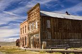 stock photo of shacks  - Historic main street buildings in an old west goldrush ghost town of Bodie California - JPG