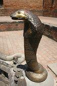 picture of king cobra  - Bronze cobra in temple in Bhaktapur in Nepal - JPG