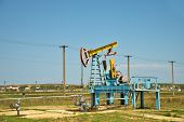 pic of nod  - Oil pumpjack or nodding horse pumping unit in Ukraine - JPG