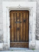 picture of poitiers  - Old wooden door with medieval carved stone lintel in Poitier France - JPG