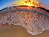 wide angle shot of beach on sunset