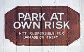 Park at Own Risk sign