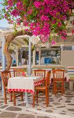 Restaurant In The Narrow Streets Of The Island Town With Flowers
