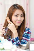 Thai Cute Girl Combing Hair