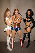 Paula Labaredas as Barbarella, Alicia Arden as Aeon Flux with Phoebe Price as Wonder Woman at San Diego Comic Con, San Diego Convention Center, San Diego, CA. 07-24-10