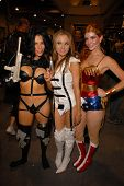 Alicia Arden as Aeon Flux, Paula Labaredas as Barbarella and Phoebe Price as Wonder Woman CelebrityCosplay,comComic Con, San Diego Convention Center, San Diego, CA. 07-24-10