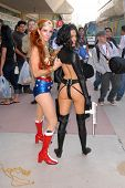 Phoebe Price as Wonder Woman and Alicia Arden as Aeon Flux at San Diego Comic Con, San Diego Convention Center, San Diego, CA. 07-24-10