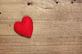 Red  felt heart on wood