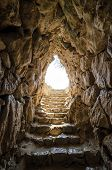 stock photo of underworld  - Exit from Mycenaean water tank reminds of way out of underworld - JPG