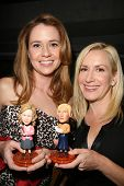 Jenna Fischer and Angela Kinsey with their bobble-heads  at the 3rd Annual Fur Ball at the Skirball,