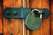 stock photo of bitcoin  - Bitcoin currency symbol on old metal padlock safety concept - JPG
