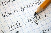 stock photo of mathematics  - math problems on graph paper with pencil - JPG