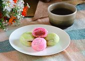 Delicious Rose Thai Pastry On Dish With Cup Of Tea