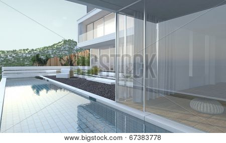 Modern luxury house with panoramic view windows overlooking a patio laid to pebbles with swimming po