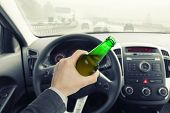 Male Holding Bottle Of Beer While Driving Car