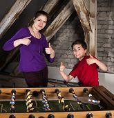 Boy And Girl  At Table Football