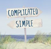stock photo of dune grass  - Direction Sign on Beach with Complicated and Simple Text - JPG
