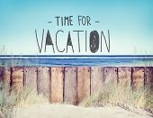 Beach and Wooden Plank Fence with Vacation Concept
