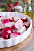 picture of vedic  - sliced ??radishes lying in a baking dish ** Note: Shallow depth of field - JPG