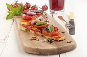 image of flat-bread  - flat bread pizza with tomato onion and basil on a wooden board - JPG