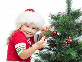 Pretty Preschool Girl Decorating Christmas Tree Isolated On White