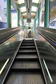 HONG KONG ISLAND, CHINA - DECEMBER 30 2013 : People using the Centra Mid-Levels escalator in Hong Ko