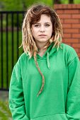 stock photo of rasta  - Young rude rasta girl with dreads in green blouse - JPG