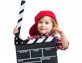 Child Girl Holding Clapper Board In Hands Isolated