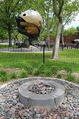 Eternal flame in the front of World Trade Center Sphere damaged at September 11 in Battery Park