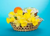 Easter cake, eggs and flowers in basket