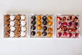 A Petit Four - Small Tartalet With Strawberry, Blueberry, Chocolate, Lemon And Mini Cupcakes