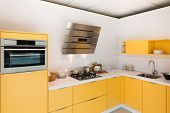 Modern Kitchen With Steel Oven And Hood