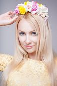 Portrait of glamour blonde lady with floral wreath
