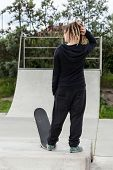 Girl With Dreadlocks And A Skateboard