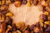 Diet Healthy Food. Border Of Raisin On Wooden Background