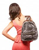 Closeup of woman with sequin silver backpack. Wearing pink mini lace dress. Isolated on the white st